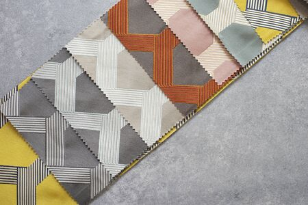 Colorful curtain fabric samples. Multiple color fabric texture samples selection fabrics for interior decoration. Curtains, tulle and furniture upholstery.