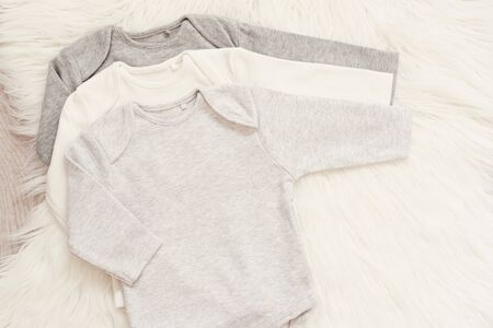 Baby Bodysuit Mockup. Styled Stock Photography. Clothes For A Boy. Jumpsuits, Rompers On A White Fur Carpet. Newborn Concept. Boy Clothes Set