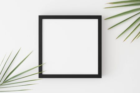Top view of a black square frame mockup with palm leaf decoration. Фото со стока - 140968462