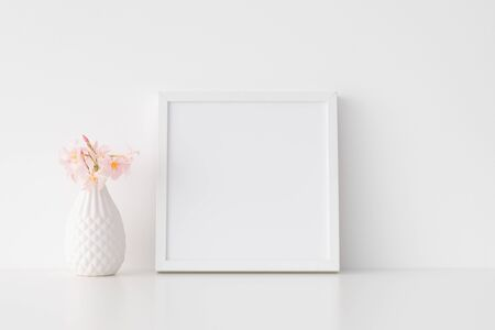 White square frame mockup with pink oleander in a vase.