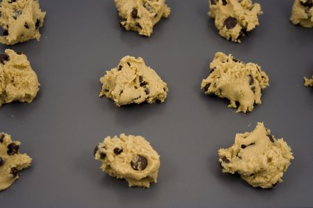 cookie sheet: A cookie sheet of chocolate chip cookies ready for the over.