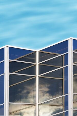 cloud reflections in office building window glass Stock Photo