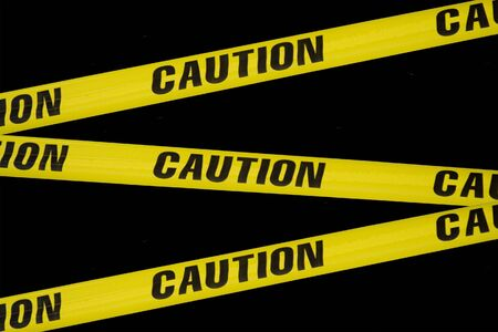 criss: criss crossing caution tape on a black background Stock Photo