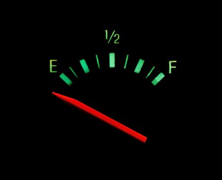 gas gauge: Gas gauge bright colors on empty on a black background Stock Photo