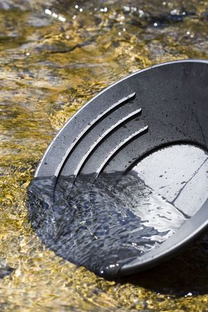 prospecting: Panning for gold in a northern michigan stream