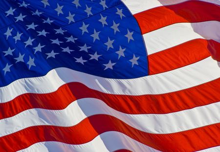 red stripe: Tilted stars and stripes flying in the wind on nice background for a patriotic display Stock Photo