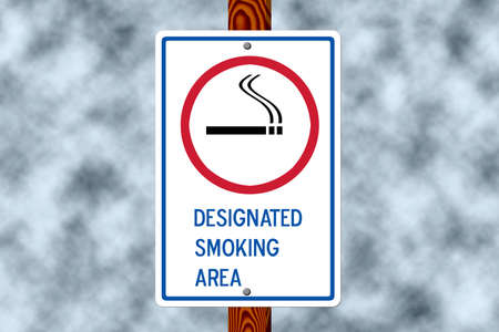 Designated smoking sign on a post against a dark smoke filled sky