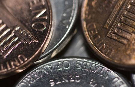 silver state: money macro photograph of pocket change focus near the center then blurring towards the edges