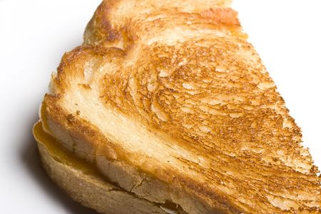 browned: grilled cheese sandwich on a white plate shot with a macro lens