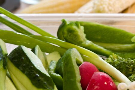 fresh vegetables cut up and in a plastic bowl Reklamní fotografie