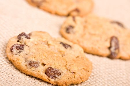 oatmeal raisin cookies on a burlap background macro fresh out of the oven photo
