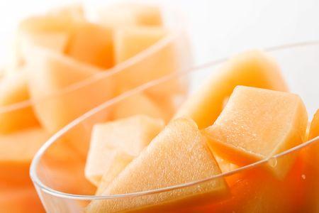 parfait: cantaloupe cut and in parfait glass light background