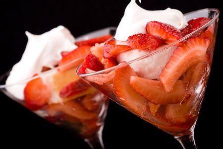Strawberry shortcake in a martini glass sponge cake and whip cream photo