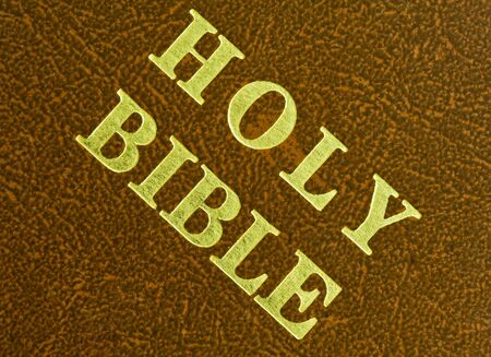 close up of a cover of the holy bible  photo