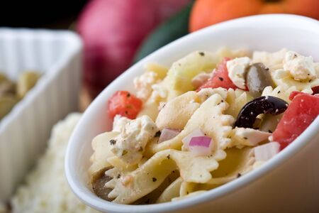 a fresh greek bow-tie pasta salad served cold Stock Photo
