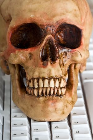 concept of how slow the internet can be skull and computer keyboard Stock Photo