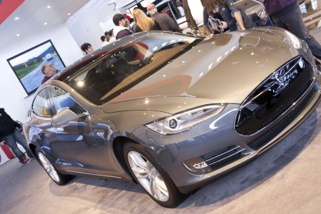 american media: DETROIT - JANUARY 27 :The new 2014 Tesla Model S eletric auto at The North American International Auto Show January 27, 2013 in Detroit, Michigan.
