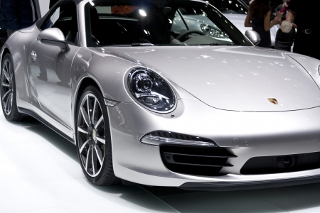 carrera: DETROIT - JANUARY 27 :The new 2013 Porsche 911 Carrera 4S Cabriolet at The North American International Auto Show January 27, 2013 in Detroit, Michigan.  Editorial
