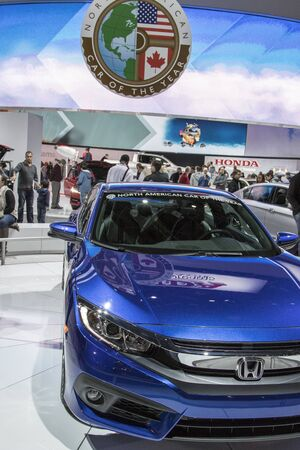 american media: DETROIT - JANUARY 17 :The 2016 North american car of the year 2017 Honda Civic at The North American International Auto Show January 17, 2016 in Detroit, Michigan. Editorial