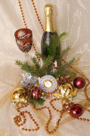 Christmas balls, clock,  glass and champagne