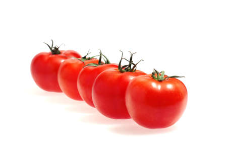 Row of tomatoes isolated on the white