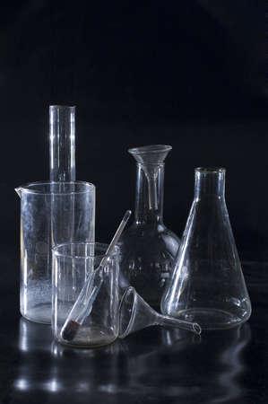 laboratory labware: Chemical ware on black background Stock Photo