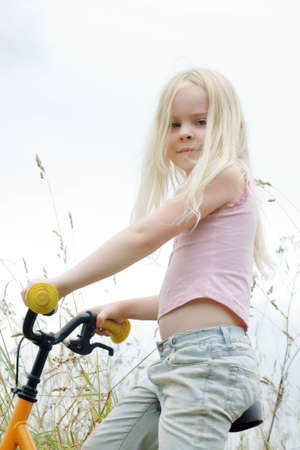 little girl sits on  bicycle outdoor Stock Photo - 11919164