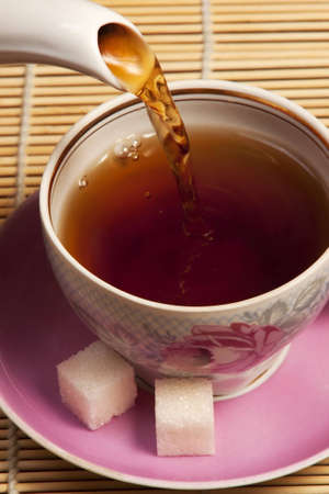 Cup in which pour tea Stock Photo
