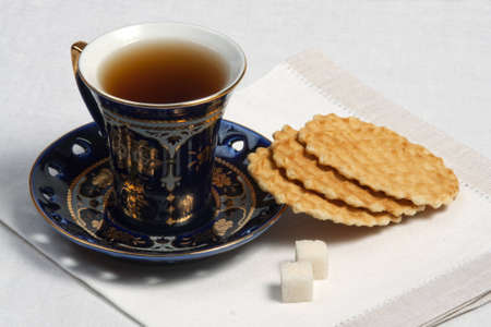 teacup and cookies on table