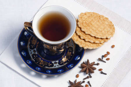 teacup, spices and cookies on table Stock Photo