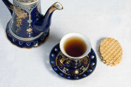 teapot, teacup and cookies on table