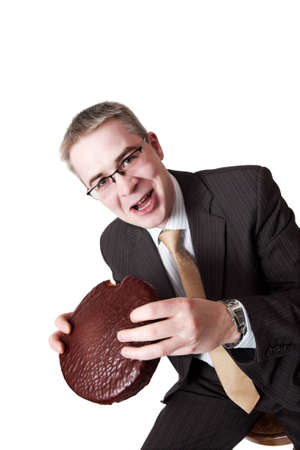 businessman with chocolate pie in hands