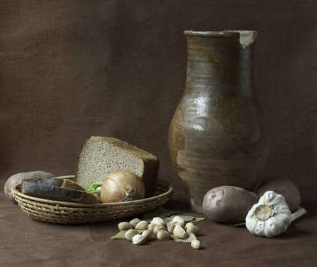 Still-life with  clay jug, bread and vegetables