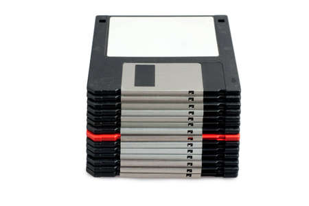 stack of black floppy disks and one red photo