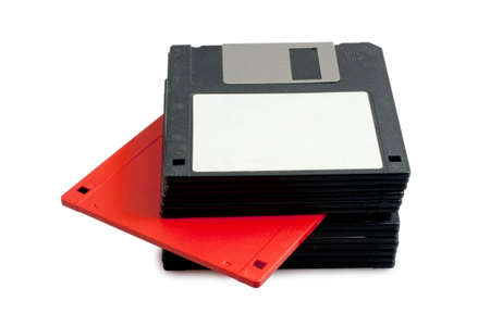 stack of black floppy disks and one red Stock Photo