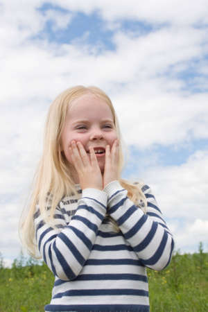 surprised little girl against cloudy sky Stock Photo - 14881547