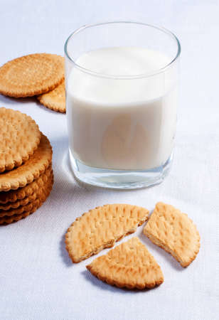 glass of milk and cookies on table