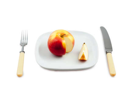 Knife, plug and plate with  incision apple Stock Photo