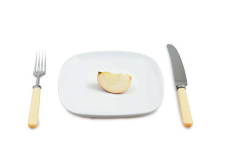 segment: Knife, plug and plate with  segment of apple