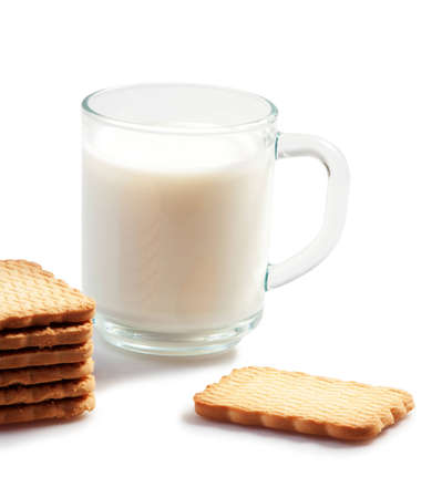 glass cup of milk and cookies on whote bacground