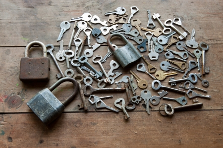 locks and lots of keys on wooden table Stock Photo - 17961159