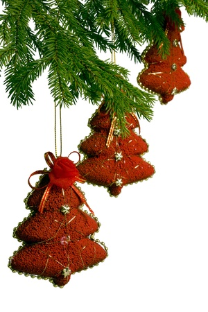 three toy red New Year trees hanging on fir-tree