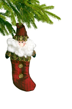 toy red New Years sock hanging on  fir-tree Stock Photo