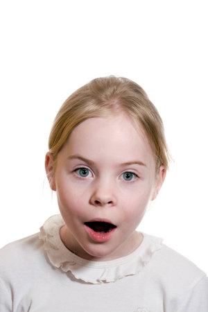 Little girl expressing amazement isolated on white background Stock Photo - 18188206
