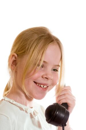girl speaks on the old telephone Stock Photo - 18188296