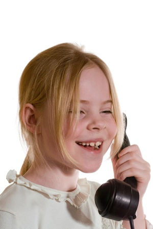 girl speaks on the old telephone photo