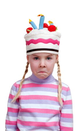 disappointed girl in ridiculous cap on white background Stock Photo - 18188487