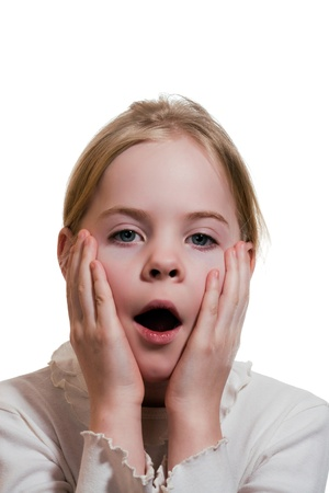 Little girl expressing amazement isolated on white background Stock Photo - 18231514