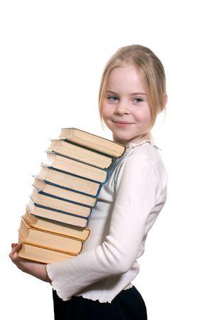 Schoolgirl holding pile of books isolated on white background photo