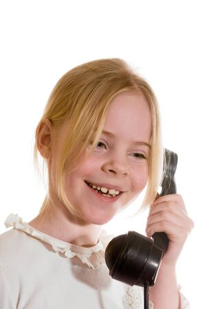 girl speaks on the old telephone Stock Photo - 18231515
